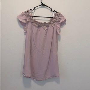 Pink off-shoulder dress with floral details